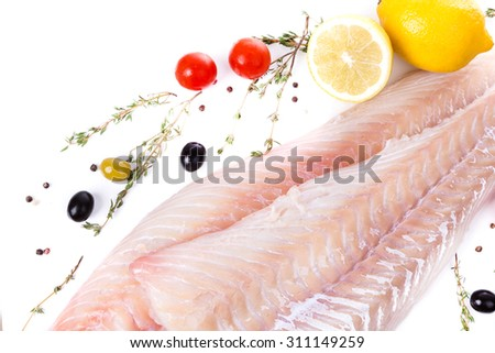 uncooked raw fillet  of cod with serving spices on white background - stock photo