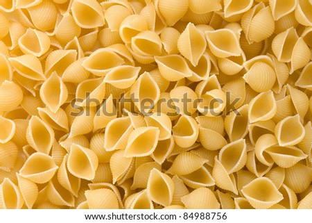 uncooked raw pasta as whole background - stock photo