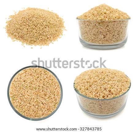 Uncooked rice in a bowl on a white background. - stock photo