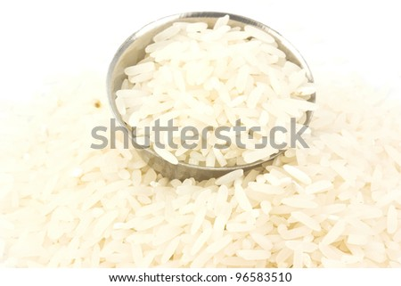 Uncooked rice in a metal bowl