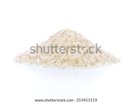 uncooked rice in a small pile on a white background