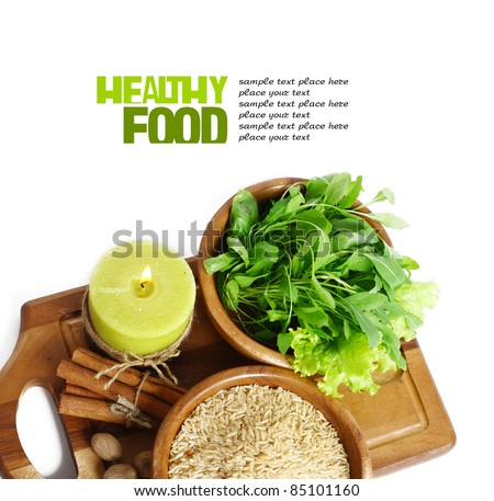 uncooked rice in wooden plate isolated on white background - stock photo