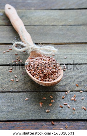 uncooked rice on wooden spoon, food close up - stock photo