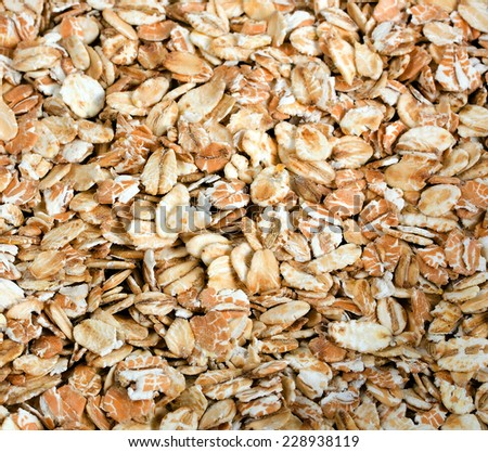 uncooked rolled oats - oatmeal background - stock photo