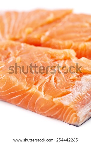 Uncooked salmon fillets isolated on white background - stock photo