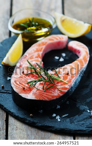 Uncooked salmon with rosemary and salt, selective focus - stock photo