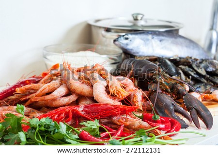 uncooked  sea food specialties in home kitchen  - stock photo