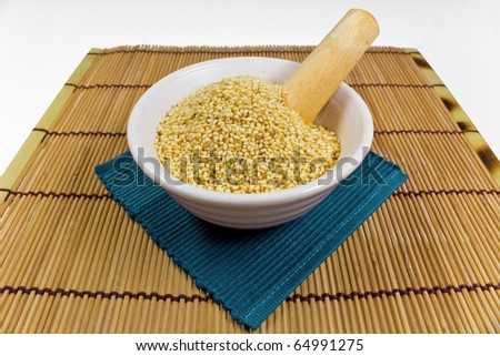 uncooked sesame in bowl - stock photo