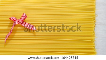 Uncooked spaghetti background - stock photo