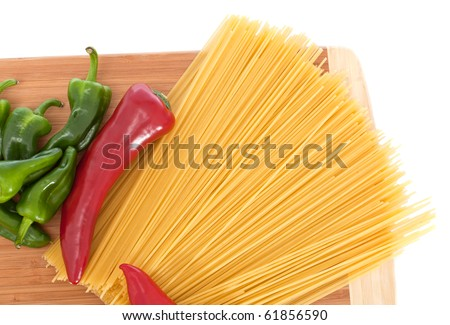 Uncooked spaghetti bolognaise with capsicums - stock photo