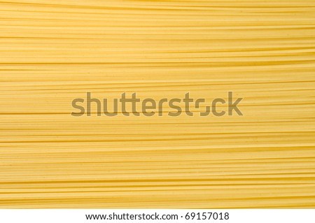uncooked spaghetti close-up as a decorative background - stock photo