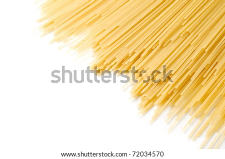 uncooked spaghetti close-up on a white background - stock photo