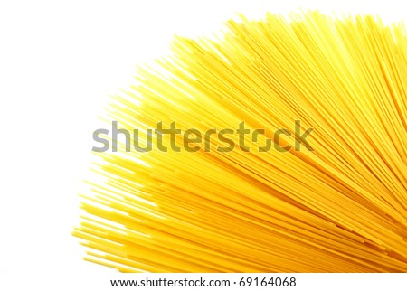uncooked spaghetti noodles isolated on a white background