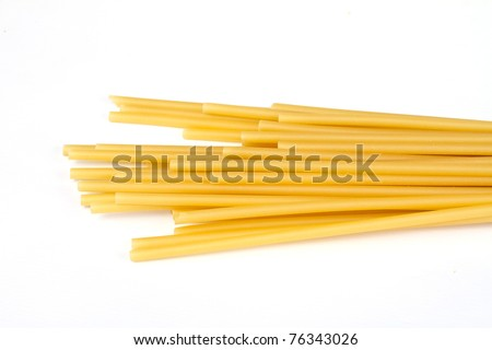 uncooked spaghetti noodles isolated on white background