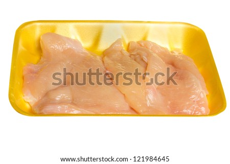 Uncooked thin sliced chicken breast cutlets in package - stock photo