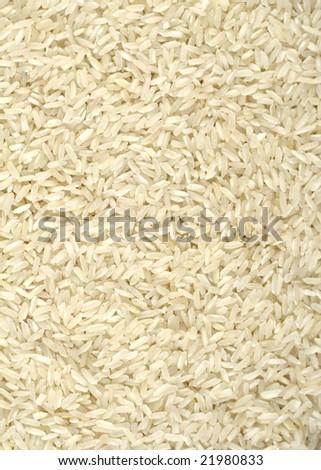 Uncooked white rice background - stock photo