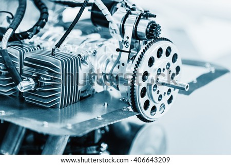 Uncovered engine small plane on a pedestal. Detail. Blue colored. - stock photo