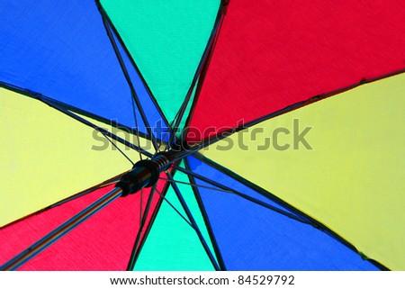 Under a Colorful Umbrella - stock photo