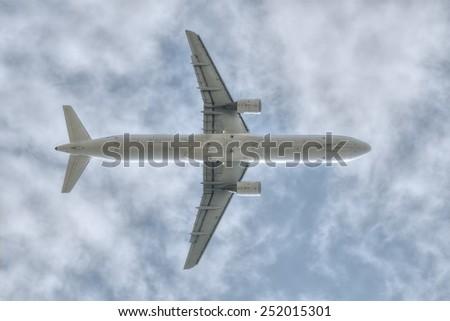 under a flying big jet plane  - stock photo