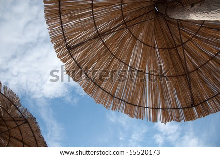 under a parasol on the beach in the mediterranean - stock photo