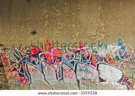 under bridge grafitti - stock photo