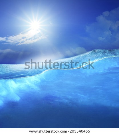 under clear sea blue water with sun shining on sky above use for ocean nature background  - stock photo