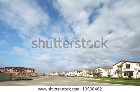 Under Construction And Newer Homes Under Beautiful Scenic Skies - stock photo