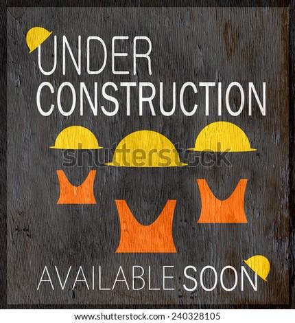 under construction design on wood grain texture - stock photo