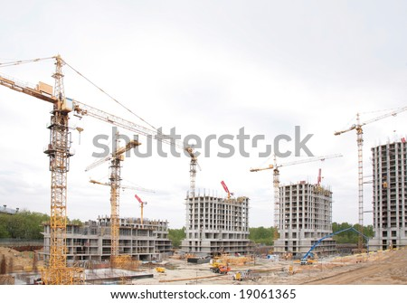 Under construction houses - stock photo