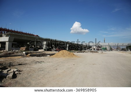 Under-construction of concrete high speed way with heavy equipment in Nonthaburi province, Thailand. - stock photo