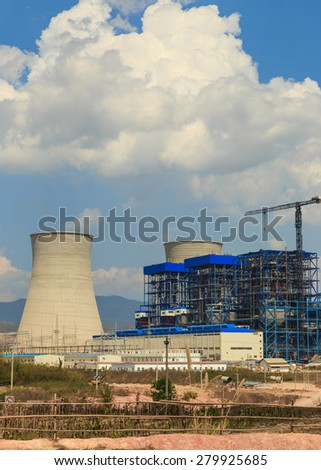 Under construction of Lignite power plant and cooler - stock photo