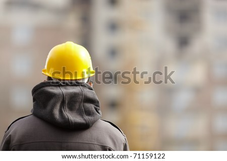 under construction , selective focus on part of hood and helmet - stock photo