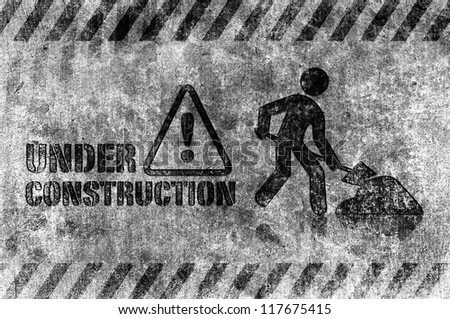 Under construction sign grunge style - stock photo