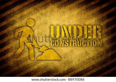 under construction sign in dark vintage style - stock photo
