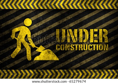under construction sign in glow yellow vintage style - stock photo