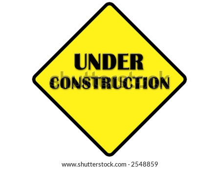 under construction sign in yellow with white isolate background - stock photo