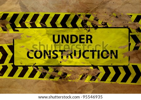 under construction sign on paper