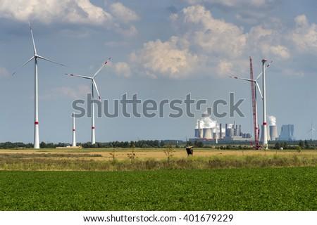 Under construction wind farm off the lignite power plants Neurath, Rhine coalfield, Germany - stock photo