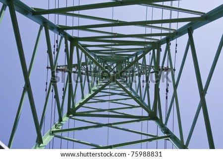Under electrical power line on blue sky background - stock photo