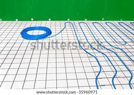 Under floor heating system in a bathroom - stock photo