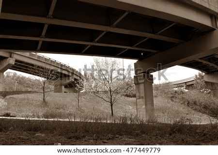 Under highway overpasses