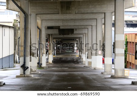 Under Interstate 5 bridge supports in the industrial area of SE Portland Oregon - stock photo