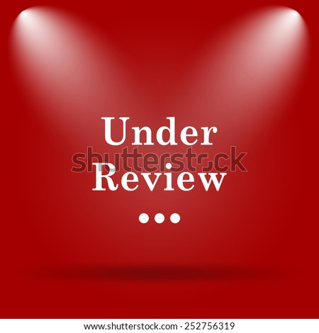 Under review icon. Flat icon on red background.  - stock photo