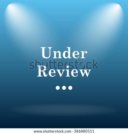 Under review icon. Internet button on blue background.   - stock photo