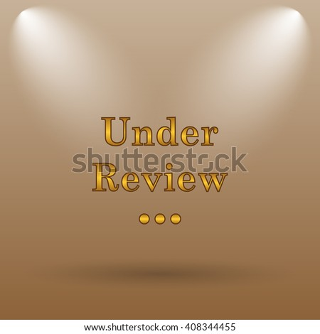 Under review icon. Internet button on brown background. - stock photo