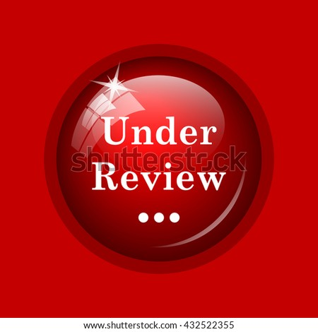Under review icon. Internet button on red background. - stock photo