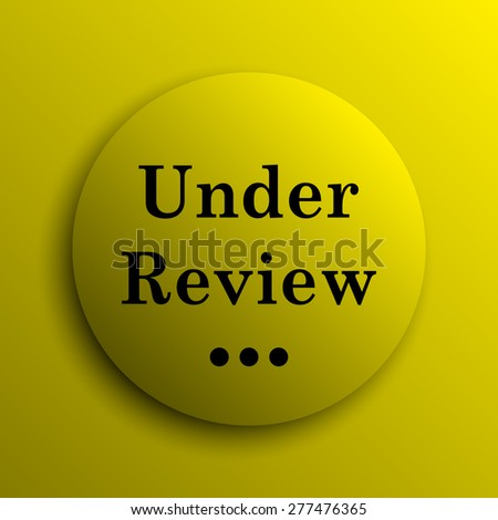 Under review icon. Yellow internet button.  - stock photo