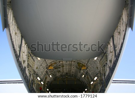 Under Side of Military C-17 Aircraft - stock photo
