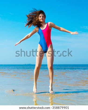 Under Sun Jumping Happy  - stock photo
