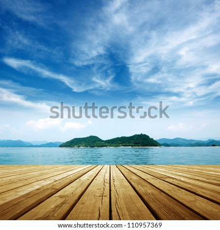 Under the blue sky,platform beside sea . - stock photo